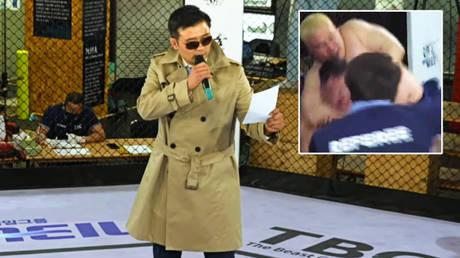'Intense': Bizarre ring announcer in trench coat barks at fighters on blood-splattered canvas at MMA scrap in South Korea (VIDEO)