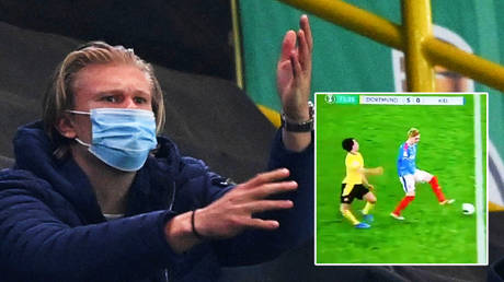 Look away now: Sickened Erling Haaland can't watch as teammate Mateu Morey suffers horror injury in Dortmund cup clash (VIDEO)
