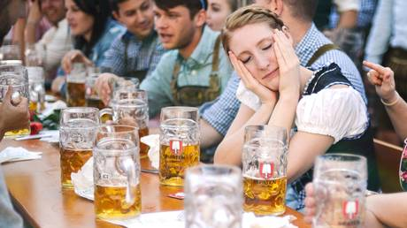 A woman in a traditional Bavarian costume sits at the table during Oktoberfest in Munich. © Reuters / Alexey Vitvitsky
