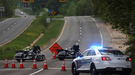 Police block Dolley Madison Boulevard in McLean, Virginia in response to a standoff at the main gate of CIA headquarters in Langley, May 3, 2021.