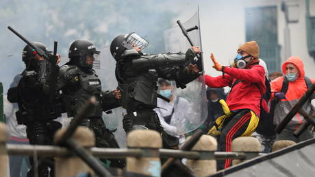 Demonstrators clash with members of security forces during a protest against the tax reform of President Ivan Duque's government in Bogota, Colombia, April 28, 2021.