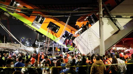 Rescuers work at a site where an overpass for a metro train partially collapsed, in Mexico City, Mexico, May 3, 2021.