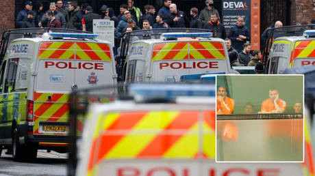 Manchester United players (inset) watched fan protests outside The Lowry Hotel © Phil Noble / Reuters