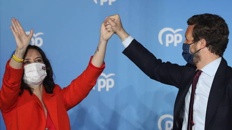 Anti-lockdown candidate Ayuso wins big in Madrid elections as Podemos party leader quits politics in defeat thumbnail
