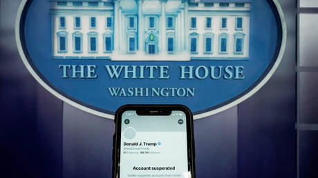 A smartphone inside the White House briefing room shows the suspended Twitter account of US President Donald Trump, January 8, 2021.