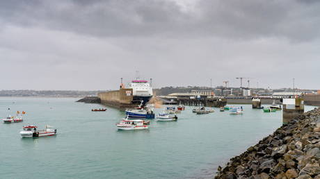 French fishing fleet is seen at the entrance to the harbour in St Helier, Jersey, May 6, 2021 © Marc Le Cornu/via REUTERS