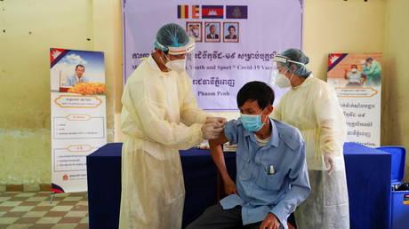 An education staff receives a dose of China's Sinovac coronavirus disease (COVID-19) vaccine at a school in Phnom Penh, Cambodia, April 1, 2021.
