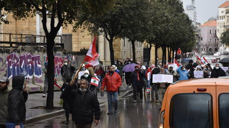 Protesters gathering at Martyrs' Square march towards Riad Al Solh Square during a protest demanding establishing a transitional government Beirut, Lebanon on April 10, 2021.