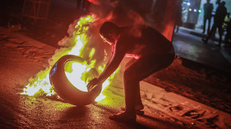 Palestinians burn tires during a demonstration condemning overnight clashes in East Jerusalem.