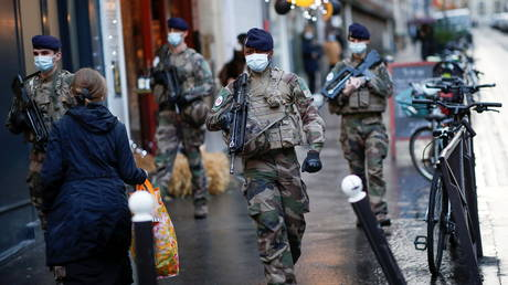 FILE PHOTO. French soldiers from the Sentinelle security operation patrol the streets in Paris, France on November 19, 2020.
