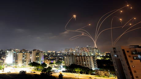 Streaks of light are seen as Israel's Iron Dome anti-missile system intercepts rockets launched from the Gaza Strip towards Israel, as seen from Ashkelon, Israel, May 10, 2021.