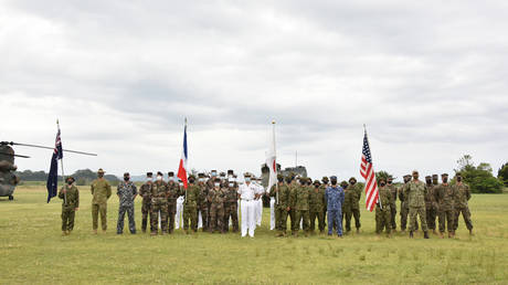 Representatives from Japan, the US, France, and Australia attending a joint military drill starting ceremony at JGSDF's Camp Ainoura in Sasebo, Nagasaki prefecture, on May 11, 2021. © AFP / Japan Ground Self-Defense Force