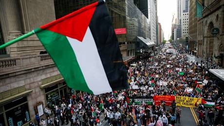 Pro-Palestinian protesters march in the Manhattan borough of New York City, May 11, 2021.