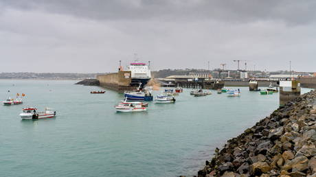 FILE PHOTO. French fishing fleet at the entrance to the harbour in St Helier, Jersey. © Reuters / Marc Le Cornu