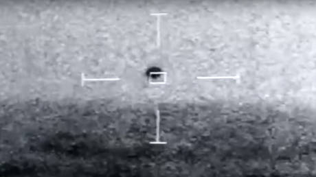 An excerpt from leaked footage showing an unidentified object over the Pacific Ocean, captured by Navy personnel.