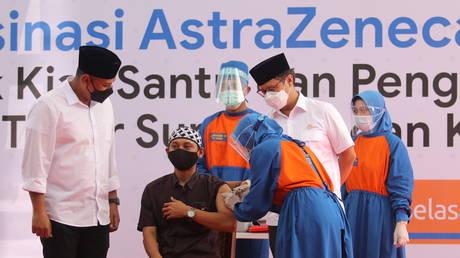 FILE PHOTO. A man receives a dose of AstraZeneca vaccine in Kediri, East Java province, Indonesia.
