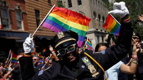 New York City police officer marches in the annual NYC Pride parade