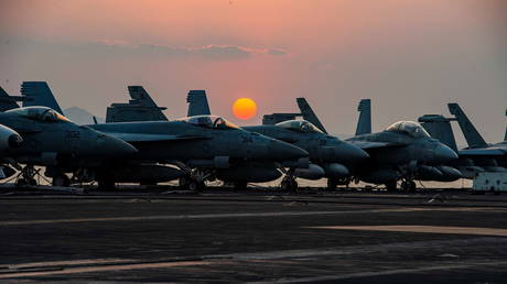 Fighter jets on the flight deck of United States Navy aircraft carrier USS Dwight D. Eisenhower on April 3, 2021.