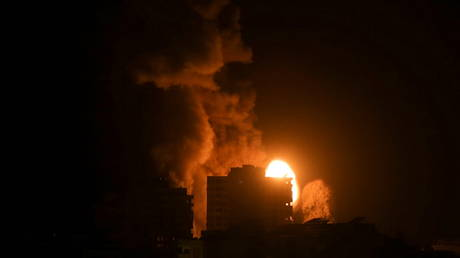 Smoke and flames rise above a building during Israeli air strikes in Gaza City on May 17, 2021.