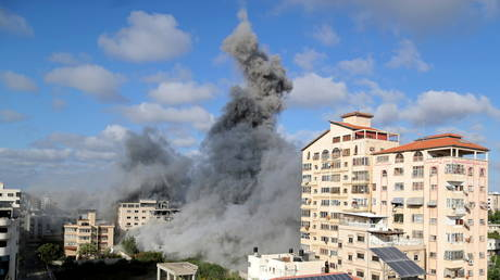 Smoke rises following an Israeli air strike, amid a flare-up of Israeli-Palestinian fighting, in Gaza City May 17, 2021.