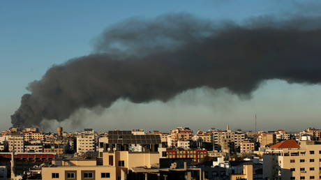 Smoke rises from a building after an Israeli airstrike in Gaza, May 15, 2021.