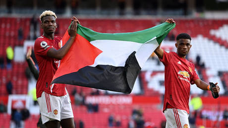 Paul Pogba showed his support for Palestine with teammate Amad Diallo. © Reuters