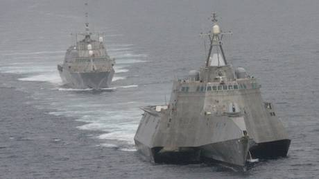 USS Freedom (rear), and USS Independence (front) maneuver together during an exercise off the coast of California, May 2012