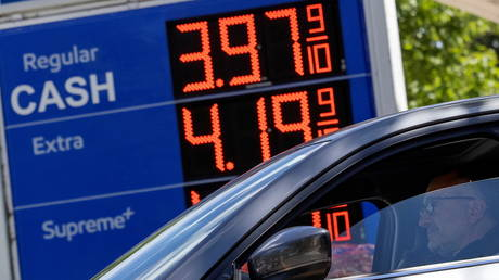 Gas prices are seen are at an Exxon gas station after a cyberattack crippled the biggest fuel pipeline in the country, run by Colonial Pipeline, in Washington, US.