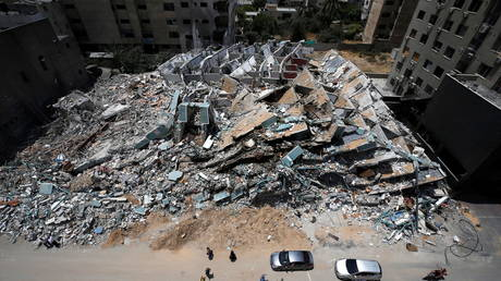A building destroyed by Israeli missile strikes in Gaza, May 21, 2021. © Mohammed Salem / Reuters