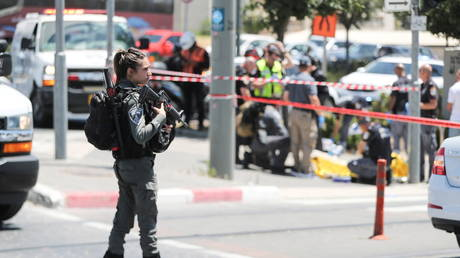 An Israeli security force member stands guard at the scene of an incident in Jerusalem May 24, 2021. © REUTERS/Ammar Awad