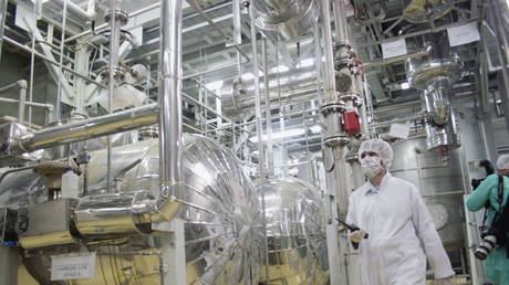 A worker walks inside of an uranium conversion facility March 30, 2005 just outside the city of Isfahan, about 254 miles (410 kilometers), south of capital Tehran, Iran.