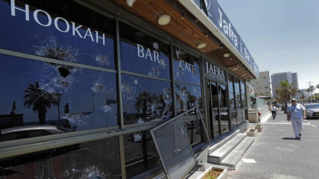 A vandalized Arab restaurant after clashes in the Israeli town of Bat Yam on May 12. © AFP / Gil Cohen-Magen
