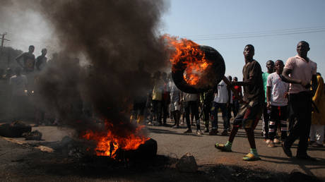 Residents of Gauraka community in Tafa Local Government Area of Niger State set bonfire on the Kaduna-Abuja highway in Gauruka, near Abuja, Nigeria, on May 24, 2021 during a protest against incessant kidnapping and killing after gunmen kidnapped 16 residents and killed three others in Niger State.