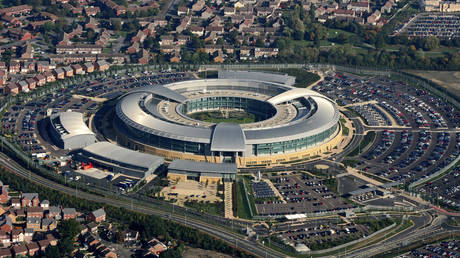 Amidst the houses and the car parks sits GCHQ the Government Communications Headquarters in this aerial photo taken on October 10, 2005. © David Goddard / Getty Images