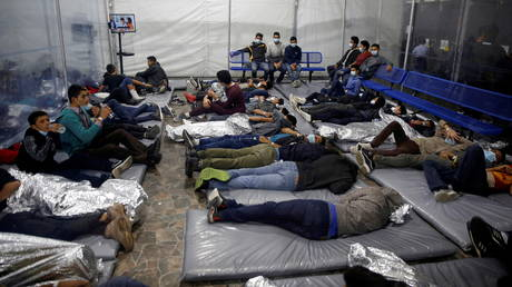 Young migrants lie inside a pod at the Donna Department of Homeland Security holding facility, the main detention centre for unaccompanied children in the Rio Grande Valley run by U.S. Customs and Border Protection, in Donna, Texas, Tuesday, March 30, 2021. © Dario Lopez-Mills / Pool via REUTERS