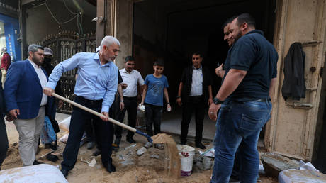 Yahya Sinwar, leader of the Palestinian Hamas movement's political wing, tours the Al-Rimal neighborhood in Gaza City, on May 26, 2021