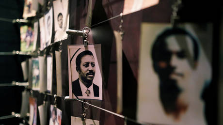 Pictures of the Rwandan Genocide victims donated by survivors are displayed at an exhibition at the Genocide Memorial in Gisozi in Kigali, Rwanda (FILE PHOTO) © REUTERS/Baz Ratner