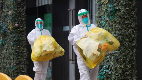 People in protective suits in Wuhan, Hubei province, China January 28, 2021.