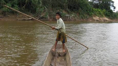 A Tsimane child in a canoe. © Chapman University