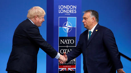 FILE PHOTO: UK Prime Minister Boris Johnson (L) and Hungarian Prime Minister Viktor Orban at an event in Watford, UK, 2019. © Christian Hartmann / AFP