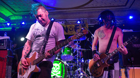 FILE PHOTO. Fat Mike, Erik Sandin, and Eric Melvin of NOFX performs onstage at Old National Centre on September in Indianapolis, Indiana. © Getty Images / Joey Foley