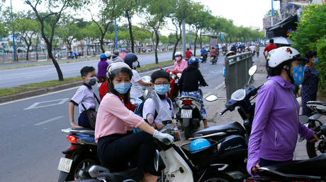 FILE PHOTO: People on the street in Ho Chi Minh, Vietnam, May 2020. © Yen Duong / Reuters