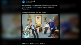 'Shrunk to fit?' Internet puzzles over peculiar photo of Bidens kneeling next to 'miniature' Jimmy Carter & his wife