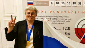 Flag-nificent victory: Checkers queen poses with Russian flag after overcoming tricolor fiasco in dramatic World Championship win