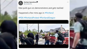 Armed standoff at Portland protest turns into scuffle after motorist and 'volunteer security' aim GUNS at each other (VIDEO)