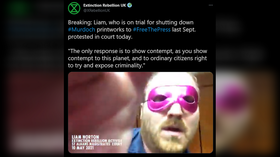 Extinction Rebellion trial delayed after defendant dons pink eye mask & GLUES HIMSELF to courtroom table (VIDEO)