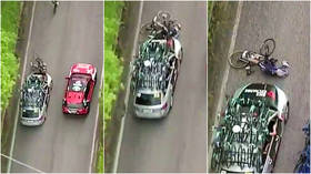 'Could have killed him': Cyclist is smashed to floor by car crashing into him from behind in horrifying mid-race collision (VIDEO)