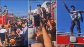 Newly-crowned UFC champ Oliveira receives hero's welcome by favela community in Brazil after stunning title win (VIDEO)