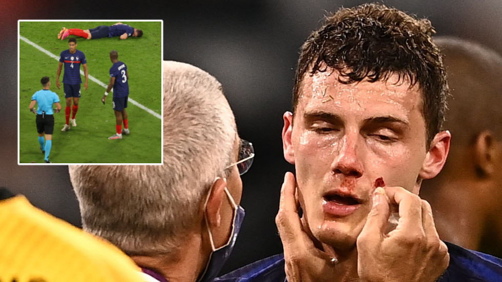Knocked out cold: Anger after France defender is allowed to play on despite losing consciousness in sickening collision (VIDEO)