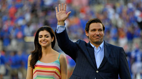 Florida Governor Ron DeSantis is shown at a 2019 college football game with his wife, Casey, in Orlando.